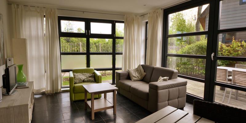 woonkamer uitbouwen kosten