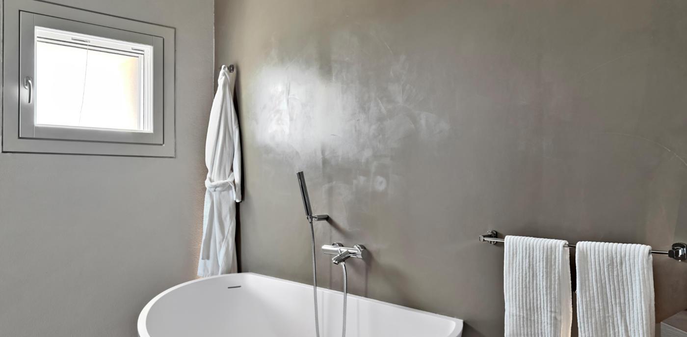 Betonlook verf kosten? Prijs betonlook muur & wanden | Slimster