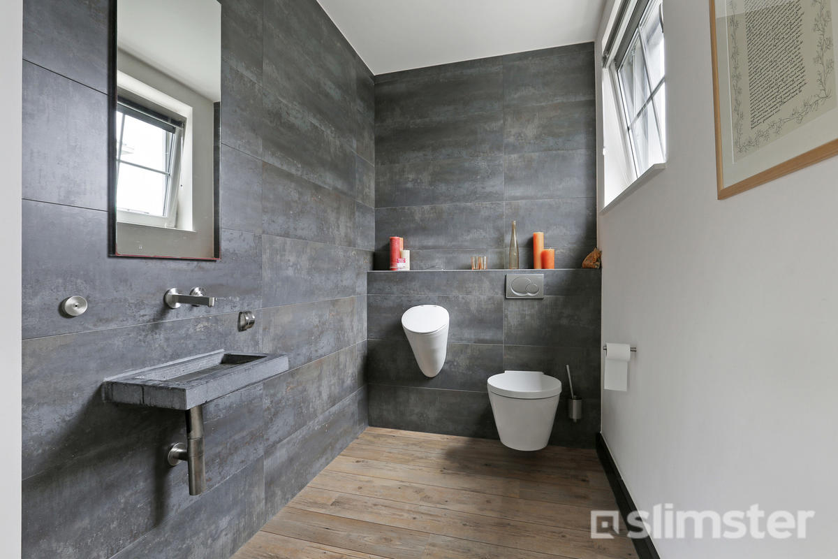 https://slimster.nl/upload/cache/photo_modal/upload/cms/18/Badkamer%20toilet%20beton%20tegels.jpg